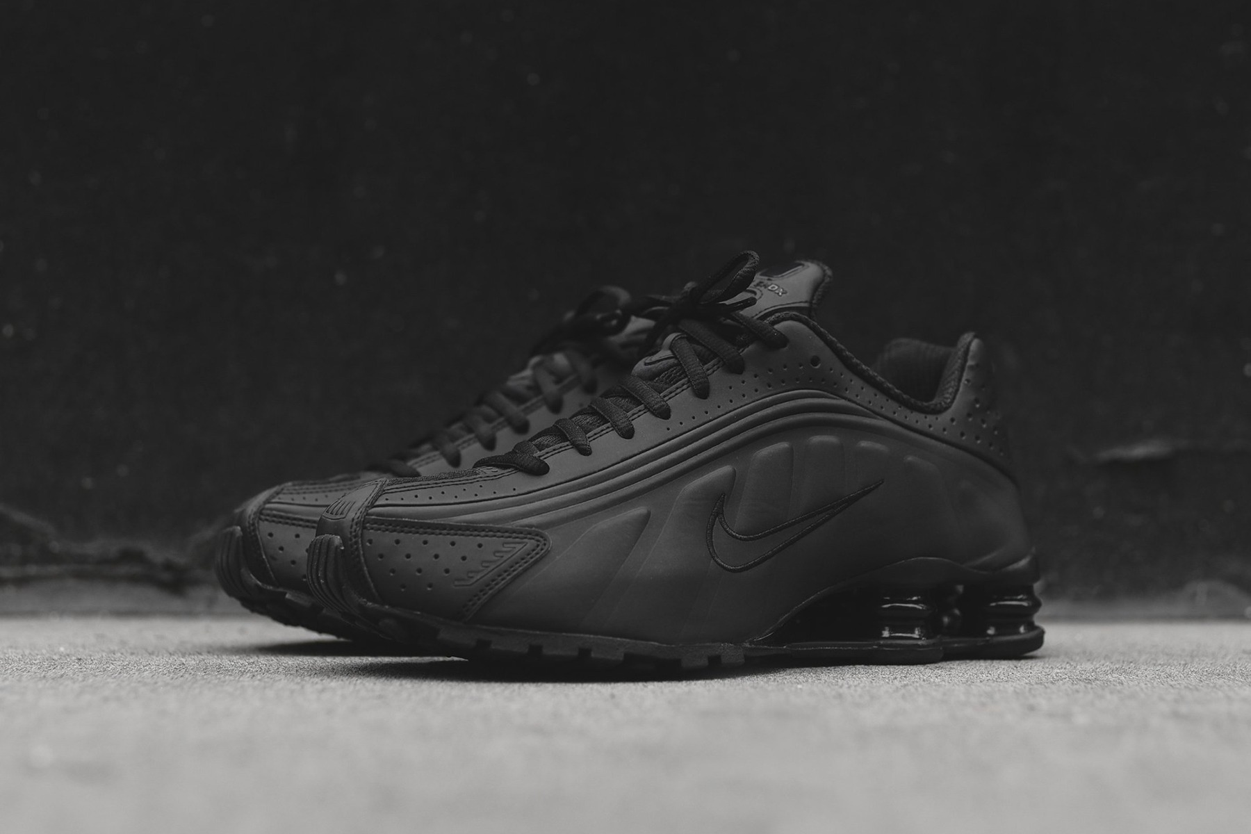 8881030253f9 Nike is pulling the Shox R4 from its archive for a 2019 run. Your options  to score the silhouette include the triple black colorway of the retro  runner.