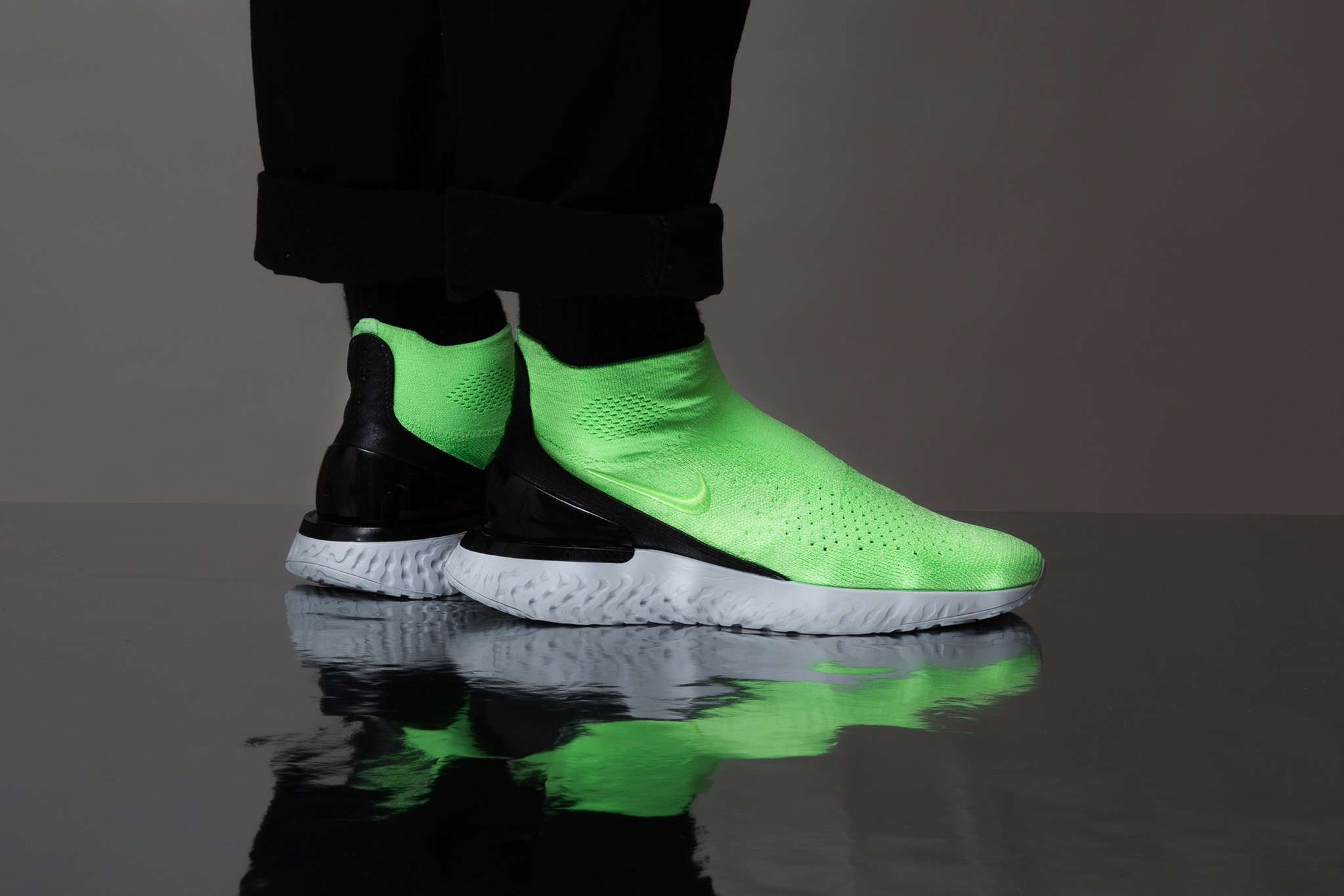 4ab7b061593560 Nike s bouncy React cushion system is the foundation for this contemporary  slip-on