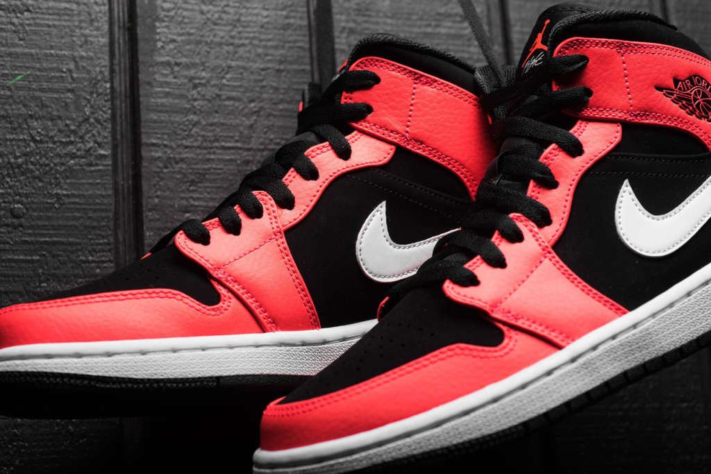 99b5b9ae030 The infrared 23 looks bright on the latest colorway of the Air Jordan 1 Mid  as its set against black suede underlay. Otherwise leather built and cut  with ...