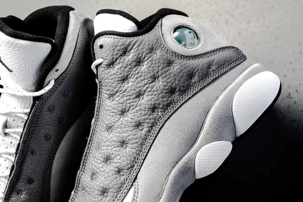 cda93a29932efb The Atmosphere Grey edition of the Air Jordan 13 Retro recently released  and can now be found at shops like Politics.
