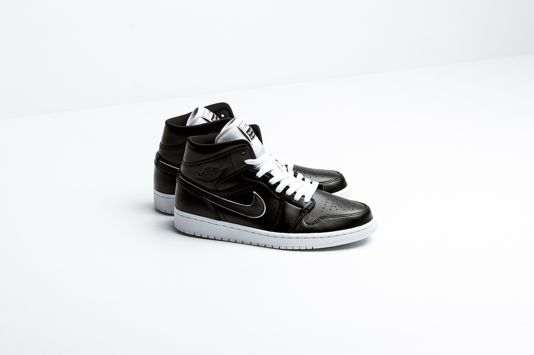 91c058f6b214 Spring 2019 sees the Air Jordan 1 Mid drop in a black and white colorway.  An SE release of the sneaker