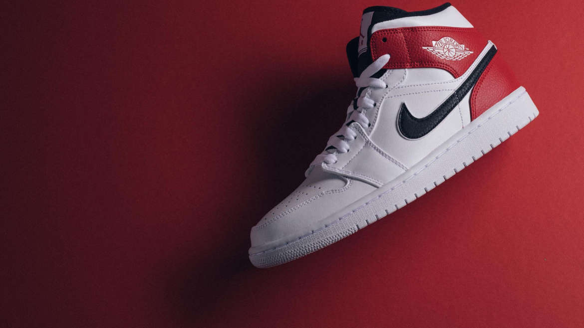 65d7ed56da5c6 Jordan Brand is working with Chicago Bulls team colors to sculpt its latest Air  Jordan 1 Mid release. The drop is leather built in mostly white with black  ...