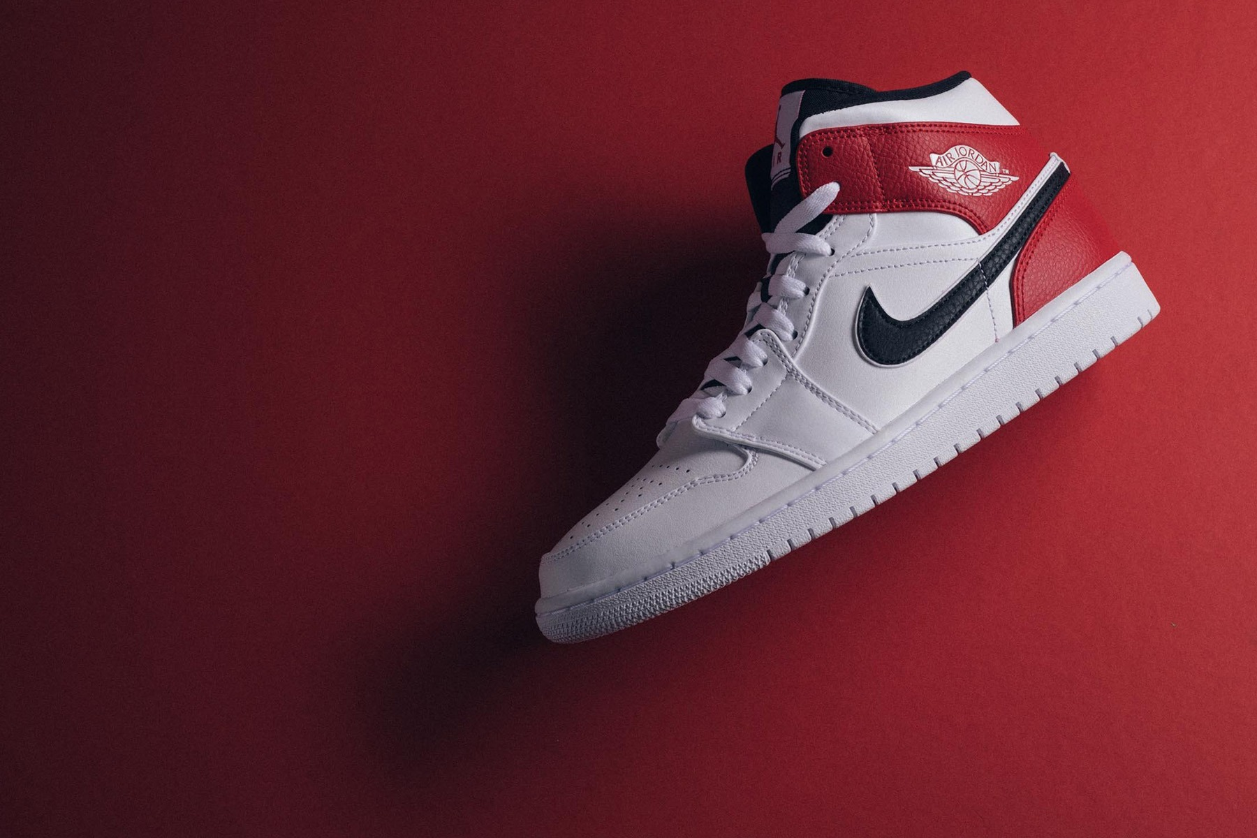separation shoes 24221 93394 Jordan Brand is working with Chicago Bulls team colors to sculpt its latest Air  Jordan 1 Mid release. The drop is leather built in mostly white with black  ...