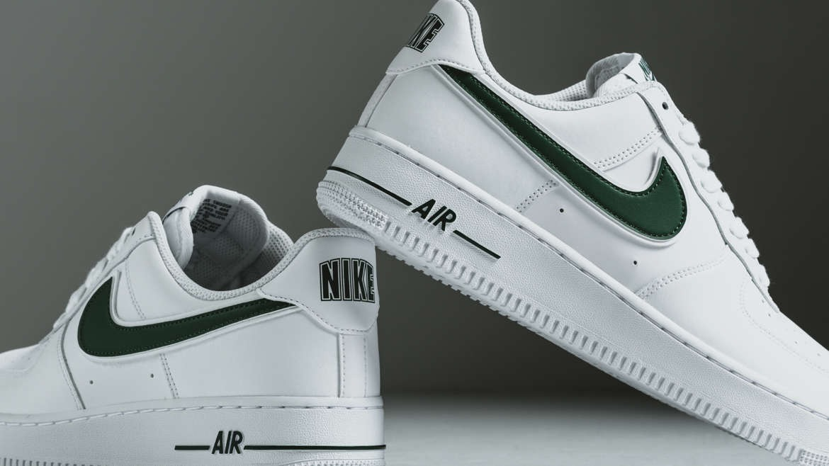 1785c7e1ba8b92 Nike has just released the Air Force 1 Low in a crisp white colorway. The  drop is accented with cosmic bonsai green on its branding elements that  includes ...