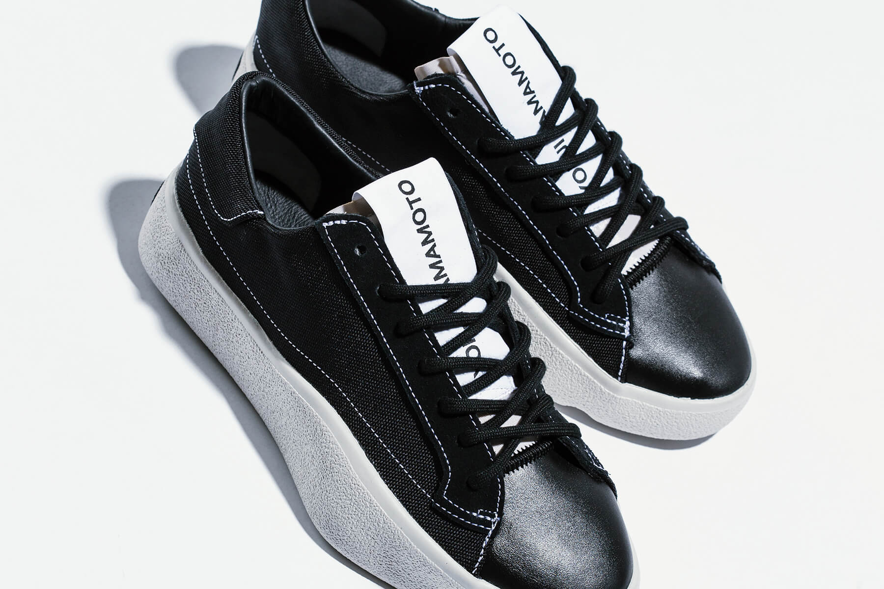 0d5915cc1b8a8 This season s offerings from adidas Y-3 include the Tangustu Lace. The  sneaker is a low top