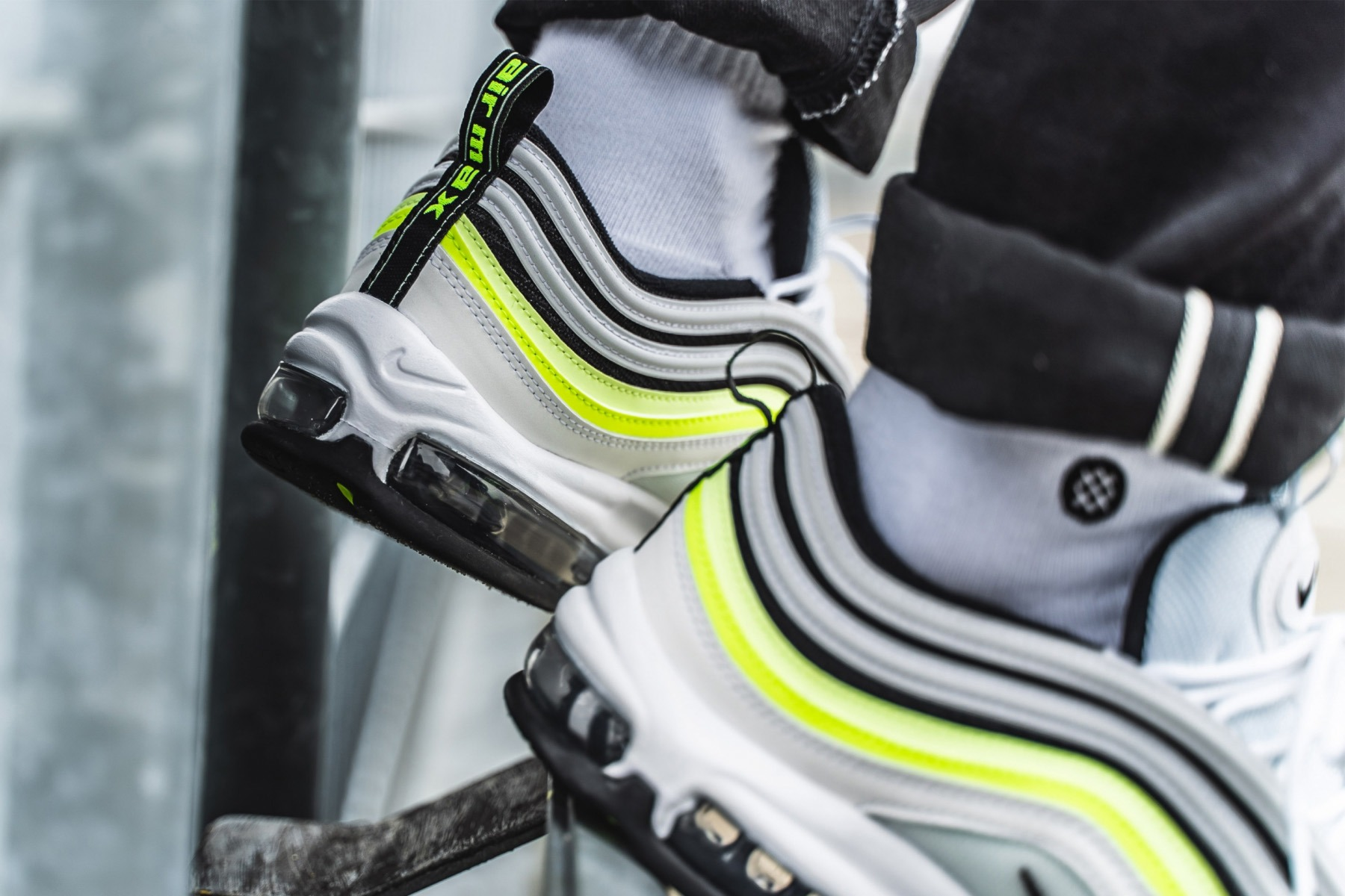 b87bd7fb Nike Sportswear has lit a collection of kicks in volt for the spring  season. Included in the collection is the Air Max 97, which applies volt  and barely ...