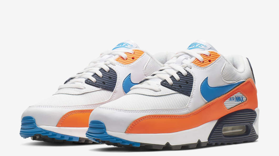 new arrival e1291 c85dc Nike Sportswear s Air Max 90 Essential line is active with a new release  for the season. The drop is employs a mix of Denver Broncos and Miami  Dolphins ...