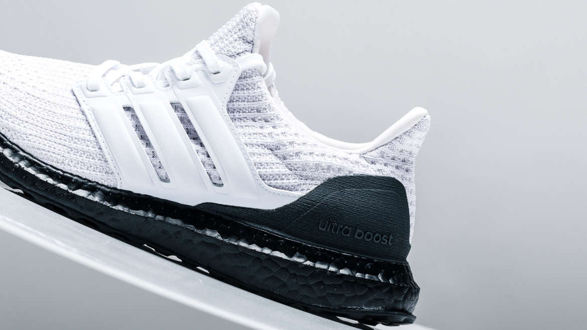 6cf462a20b8c6 A fresh drop of the adidas Ultraboost 4.0 has just landed at shops in a  contrasty colorway. The drop stands on a black BOOST sole with the upper  setting a ...