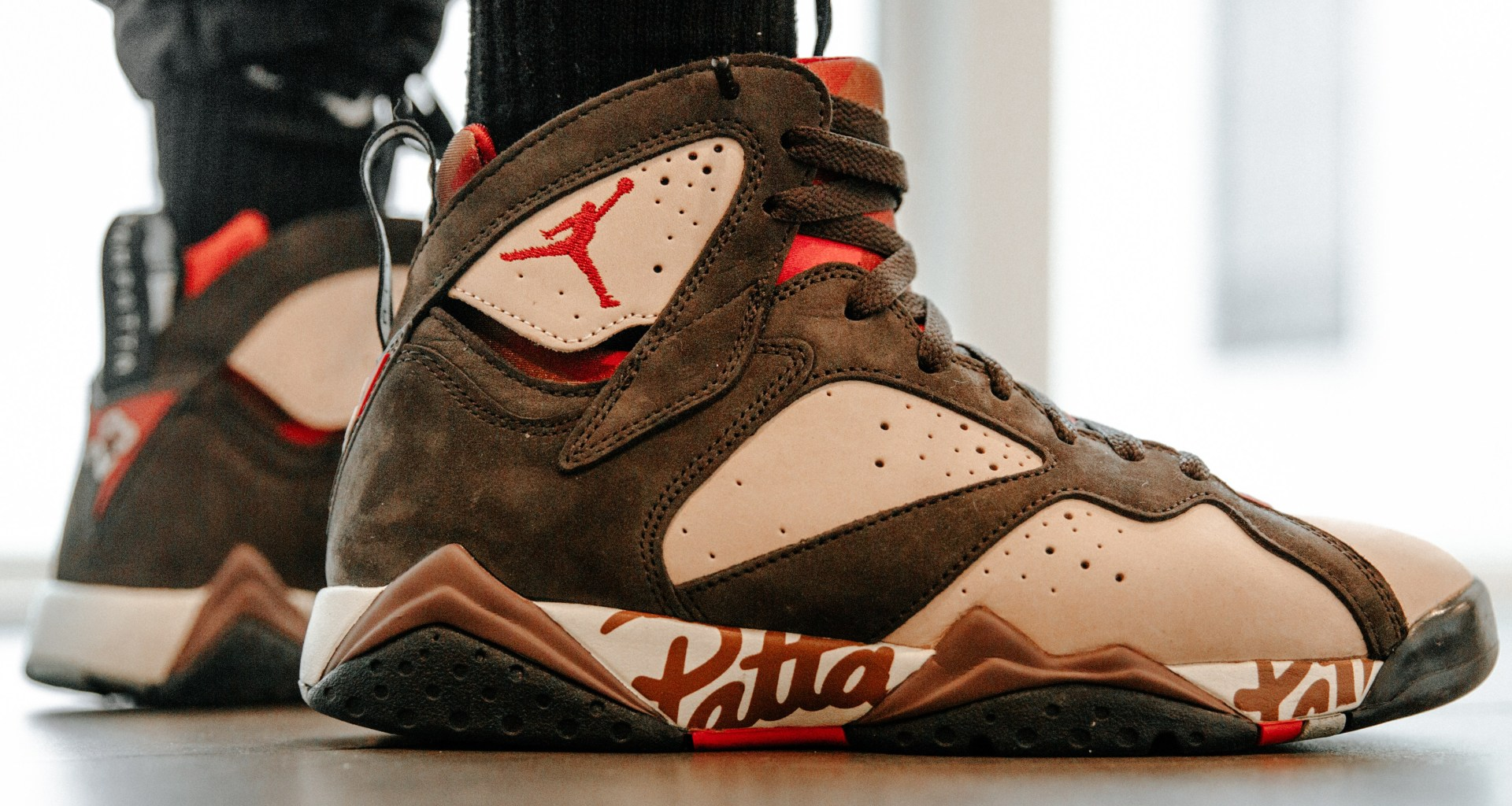 6bebbdcd1865 Here is our best look yet at the upcoming Air Jordan 7 x Patta. The  Amsterdam based shop has dressed the sneaker in Shimmer Tough Red-Velvet  Brown-Mahogany ...
