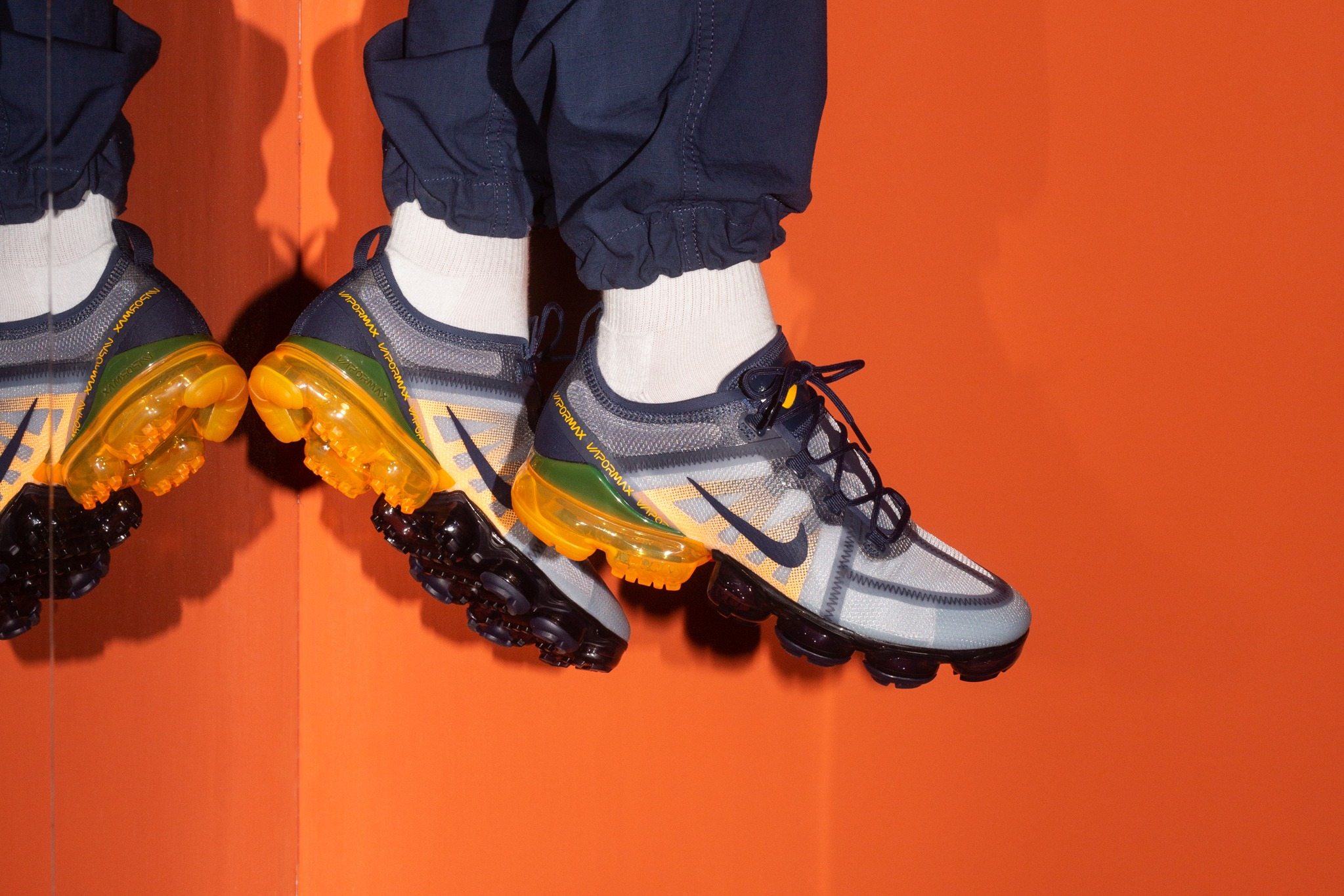 24062453f76af Nike Running is working with a midnight navy and laser orange color mix to  style its latest Air VaporMax 2019 release. The drop has a daybreak vibe  with its ...