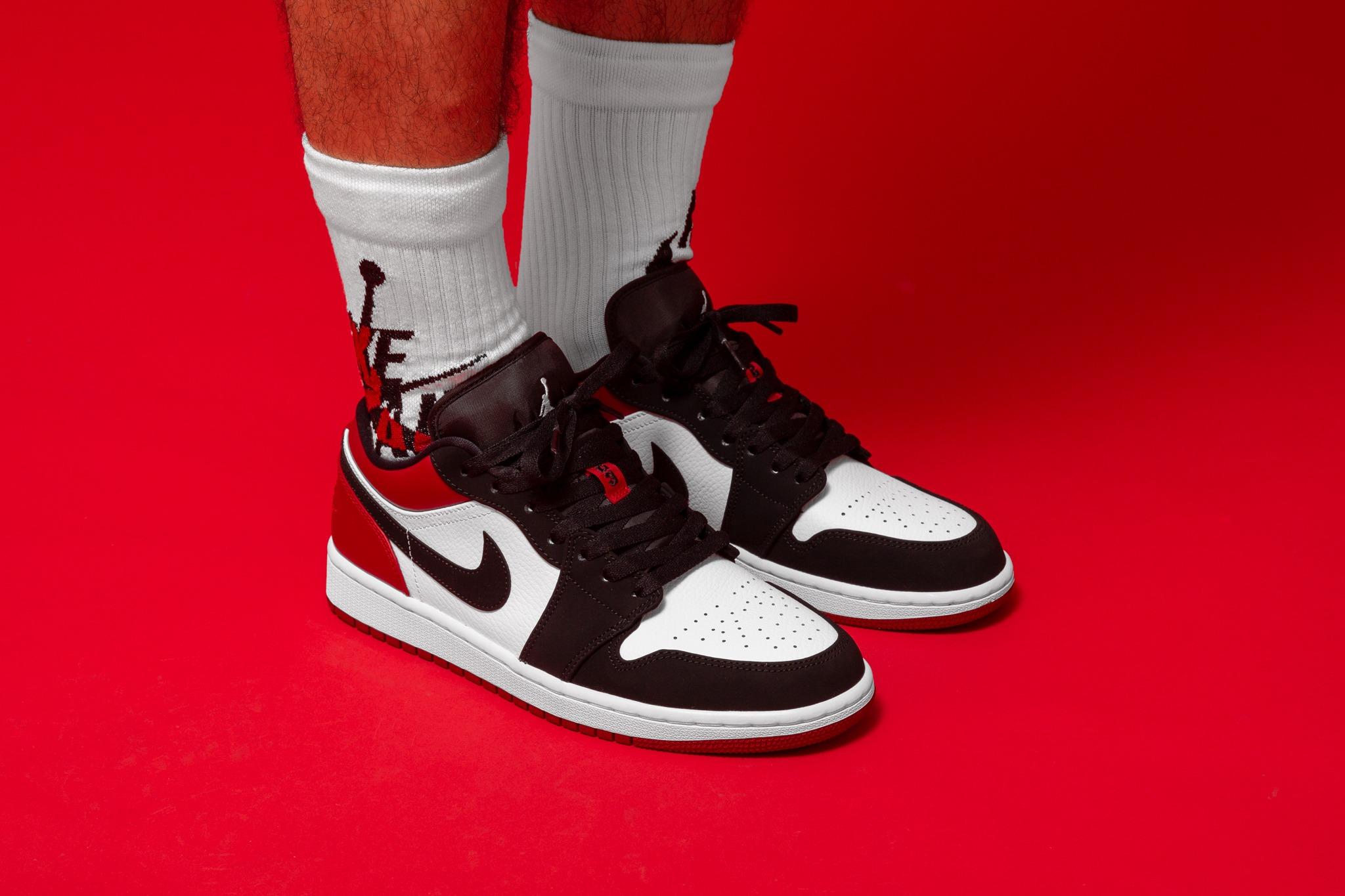 Air Jordan 1 Low in White/Black-Gym Red